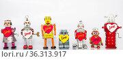 Lotts of retro robots in love. Стоковое фото, фотограф Zoonar.com/charles taylor / easy Fotostock / Фотобанк Лори