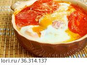 Shopska siren in guveche - Bulgarian feta cheese in a pot with tomatoes... Стоковое фото, фотограф Zoonar.com/MYCHKO / easy Fotostock / Фотобанк Лори