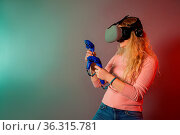 Woman using a gaming gadget for virtual reality. Augmented reality... Стоковое фото, фотограф Zoonar.com/Oksana Shufrych / easy Fotostock / Фотобанк Лори