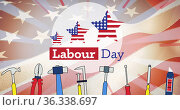 Image of labor day text, with stars and stripe stars and tools, over american flag, on blue. Стоковое фото, агентство Wavebreak Media / Фотобанк Лори