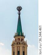 Moscow, Russia - 11 July. 2021. spire with star on roof of Leningradskaya Hotel (Hilton Moscow Leningradskaya). One of 7 Stalinist skyscrapers. Редакционное фото, фотограф Володина Ольга / Фотобанк Лори