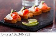 Tasty canape with salmon and olives. Стоковое фото, фотограф Яков Филимонов / Фотобанк Лори