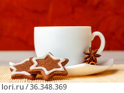Star shaped chocolate chip cookies with anise with a cup of tea. Стоковое фото, фотограф Анна Гучек / Фотобанк Лори