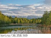 Kleiner See bei der Eichmühle am Nordrand von Bad Tölz, im Hintergrund... Стоковое фото, фотограф Zoonar.com/Hans Eder / easy Fotostock / Фотобанк Лори