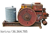 Retro small tractors diesel engine whith wheel. The metal equipment... Стоковое фото, фотограф Zoonar.com/Aleksandr Volkov / easy Fotostock / Фотобанк Лори