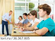 Pupils sitting in class and listening. Стоковое фото, фотограф Яков Филимонов / Фотобанк Лори