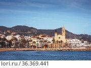 Beachfront by Sitges town with Sant Bartomeu i Santa Tecla church... Стоковое фото, фотограф Mehul Patel / age Fotostock / Фотобанк Лори