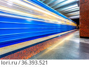 Blue subway train in motion at the underground station. Стоковое фото, фотограф Zoonar.com/Alexander Blinov / easy Fotostock / Фотобанк Лори