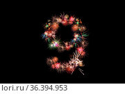 Number 9. Number alphabet made of real fireworks. See other numbers... Стоковое фото, фотограф Zoonar.com/DAVID HERRAEZ CALZADA / easy Fotostock / Фотобанк Лори