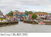 Fishing village named Neuharlingersiel located in East Frisia, Germany. Стоковое фото, фотограф Zoonar.com/Achim Prill / easy Fotostock / Фотобанк Лори
