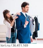 Professional tailor taking measurements for formal suit. Стоковое фото, фотограф Elnur / Фотобанк Лори
