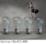 Businesswoman in new idea concept with light bulb. Стоковое фото, фотограф Elnur / Фотобанк Лори