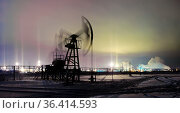 Oil and gas industry. Panoramic of a pumpjack on a oilfield and oil... Стоковое фото, фотограф Zoonar.com/BASHTA / easy Fotostock / Фотобанк Лори
