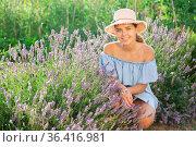 Young lady squatting beside lavender shrub. Стоковое фото, фотограф Яков Филимонов / Фотобанк Лори
