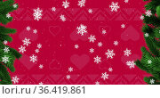 Digital image of snow flakes falling over red christmas traditional pattern. Стоковое фото, агентство Wavebreak Media / Фотобанк Лори