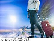 Girl with suitcase on wheels. Стоковое фото, фотограф Яков Филимонов / Фотобанк Лори