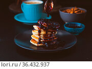 Stack of American pancakes with blueberry jam in the dark mood style... Стоковое фото, фотограф Zoonar.com/Oksana Shufrych / easy Fotostock / Фотобанк Лори