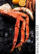Set of seafood: red and black caviar, limb of hairy crab, limb of... Стоковое фото, фотограф Zoonar.com/Ruslan Olinchuk / easy Fotostock / Фотобанк Лори