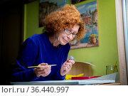 Learning new hobbies during the Coronavirus quarantine and lockdown... Стоковое фото, фотограф Zoonar.com/Yelizaveta Tomashevska / easy Fotostock / Фотобанк Лори