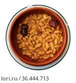 Beans stew Fabada with pork, morcilla and chorizo in clay bowl. Стоковое фото, фотограф Яков Филимонов / Фотобанк Лори
