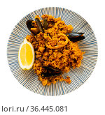 Popular dish of Spanish cuisine is paella with seafood. Стоковое фото, фотограф Яков Филимонов / Фотобанк Лори