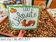 Dried walnuts on sale at the local food market. Hand written plasticized... Стоковое фото, фотограф Zoonar.com/VALMEDIA / easy Fotostock / Фотобанк Лори