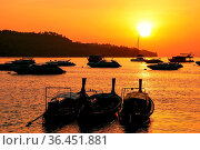 Silhouetted longtail boats at sunrise on Ao Ton Sai, Phi Phi Don Island... Стоковое фото, фотограф Zoonar.com/Don Mammoser / easy Fotostock / Фотобанк Лори