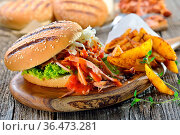 Barbecue pulled pork sandwich with coleslaw, hot BBQ sauce and potato... Стоковое фото, фотограф Zoonar.com/Karl Allgaeuer / easy Fotostock / Фотобанк Лори