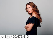 Portrait of woman with wavy hair on gray background. Стоковое фото, фотограф Zoonar.com/Max / easy Fotostock / Фотобанк Лори