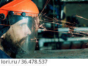 Man worker in transparent protective mask works on metal with circular... Стоковое фото, фотограф Zoonar.com/Max / easy Fotostock / Фотобанк Лори