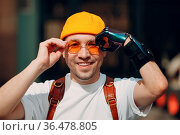 Young disabled man portrait put on yellow glasses with artificial... Стоковое фото, фотограф Zoonar.com/Max / easy Fotostock / Фотобанк Лори