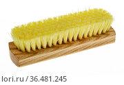 Новая щетка для одежды с желтой щетиной на белом фоне. Стоковое фото, фотограф Румянцева Наталия / Фотобанк Лори