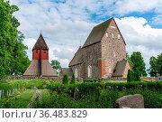 Gamla Uppsala, Sweden - 24 June, 2021: the historic old and new church... Стоковое фото, фотограф Zoonar.com/Nando Lardi / easy Fotostock / Фотобанк Лори