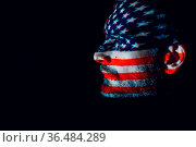 Adult man with USA flag on his face in the dark. Independence Day... Стоковое фото, фотограф Zoonar.com/Max / easy Fotostock / Фотобанк Лори
