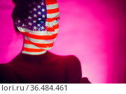 Young woman with USA flag on her face. Стоковое фото, фотограф Zoonar.com/Max / easy Fotostock / Фотобанк Лори