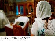 Orthodox Christian parishioner praying in the church. Стоковое фото, фотограф Zoonar.com/Max / easy Fotostock / Фотобанк Лори