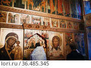 Orthodox Christian priest and parishioner praying at icons in the... Стоковое фото, фотограф Zoonar.com/Max / easy Fotostock / Фотобанк Лори