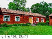 Gamla Uppsala, Sweden - 24 June, 2021: idyllic red house in the Swedish... Стоковое фото, фотограф Zoonar.com/Nando Lardi / easy Fotostock / Фотобанк Лори