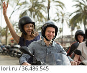 friends of tourists of different generations enjoy a ride on electric scooters. Стоковое фото, фотограф Татьяна Яцевич / Фотобанк Лори