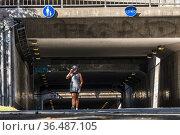 Stockholm, Sweden A woman walking in an underground passage at Gullmarsplan... Редакционное фото, фотограф A. Farnsworth / age Fotostock / Фотобанк Лори