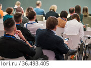Audience listens to the lecturer at the business conference. Стоковое фото, фотограф Антон Гвоздиков / Фотобанк Лори