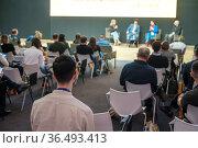 Audience listens to the lecturer. Стоковое фото, фотограф Антон Гвоздиков / Фотобанк Лори