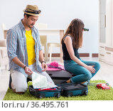 Young family packing for vacation travel. Стоковое фото, фотограф Elnur / Фотобанк Лори