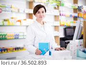 Pharmacist ready to assist in choosing at counter. Стоковое фото, фотограф Яков Филимонов / Фотобанк Лори