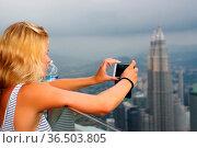 KUALA LUMPUR, MALAYSIA - January 17, 2016: Travel and technology. ... Стоковое фото, фотограф Zoonar.com/PAUL WASCHTSCHENKO / age Fotostock / Фотобанк Лори