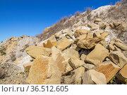 Sunny illuminated spoil pile with big stones. Стоковое фото, фотограф Zoonar.com/Achim Prill / easy Fotostock / Фотобанк Лори