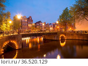 One of the famous canal of Amsterdam, the Netherlands at dusk. Стоковое фото, фотограф Zoonar.com/Yuri Dmitrienko / easy Fotostock / Фотобанк Лори