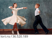 Young dancers boy and girl dancing in ballroom dance Samba. Стоковое фото, фотограф Zoonar.com/Max / easy Fotostock / Фотобанк Лори