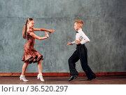 Young couple boy and girl dancing in ballroom dance Samba. Стоковое фото, фотограф Zoonar.com/Max / easy Fotostock / Фотобанк Лори