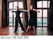 Young couple boy and girl dancing ballroom dance Rumba. Стоковое фото, фотограф Zoonar.com/Max / easy Fotostock / Фотобанк Лори